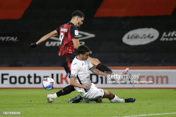 Kyle Naughton of Swansea City slides in to stop Dominic Solanke of Bournemouth during the Sky Bet Championship match between AFC Bournemouth and...