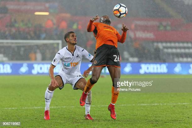 Kyle Naughton of Swansea City stands behind Bright Enobakhare of Wolverhampton Wanderers during the Emirates FA Cup match between Swansea and...