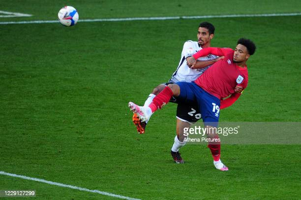 Kyle Naughton of Swansea City vies for possession with Josh Koroma of Huddersfield Town during the Sky Bet Championship match between Swansea City...