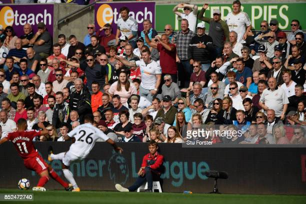 Kyle Naughton of Swansea is encouraged by the fans to get the ball forward during the Premier League match between Swansea City and Watford at...