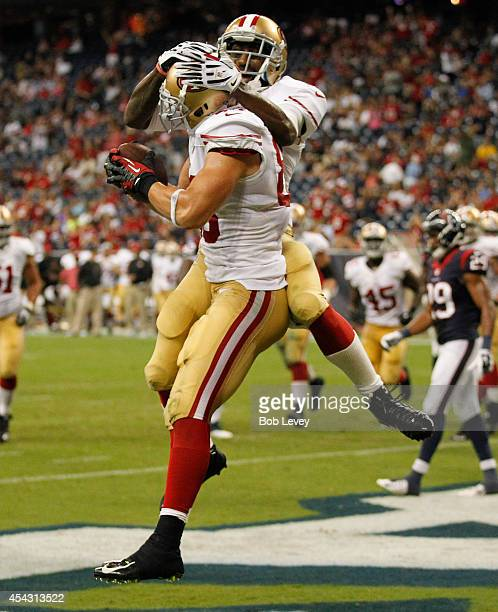 Kyle Nelson of the San Francisco 49ers celebrates with Lance Lewis after scoring on a two yard pass in the fourth quarter against the Houston Texans...
