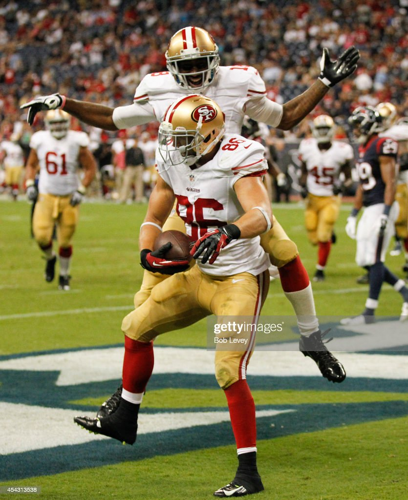 Kyle Nelson #86 of the San Francisco 49ers celebrates with Lance Lewis #18 after scoring on a two yard pass in the fourth quarter against the Houston Texans at Reliant Stadium on August 28, 2014 in Houston, Texas.