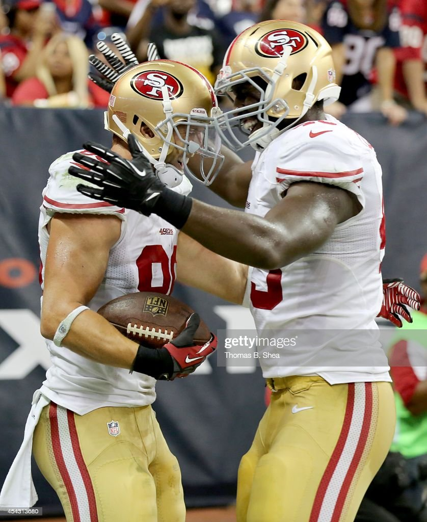 Kyle Nelson #86 of the San Francisco 49ers is congratulated by a teammate after scoring a touchdown against the Houston Texans in the second half in a pre-season NFL game on August 28, 2014 at NRG Stadium in Houston, Texas. The 49ers won 40 to 13.