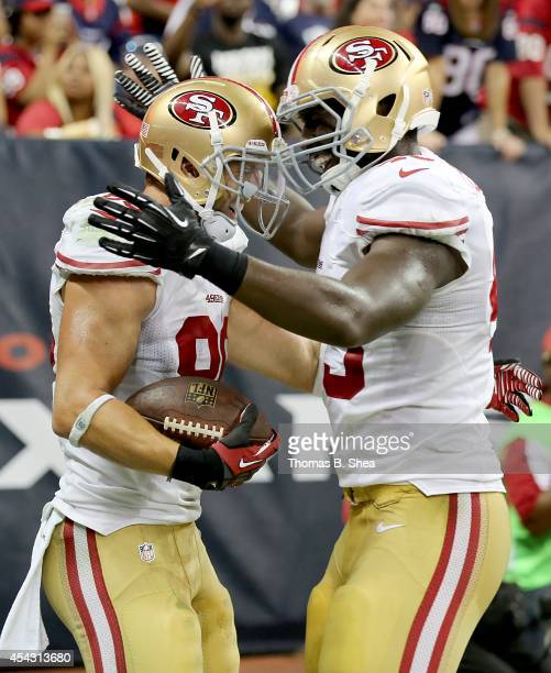 Kyle Nelson of the San Francisco 49ers is congratulated by a teammate after scoring a touchdown against the Houston Texans in the second half in a...