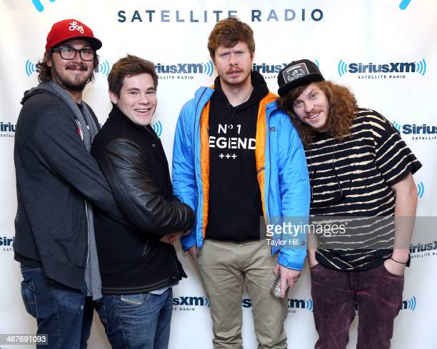 Kyle Newacheck Adam DeVine Anders Holm and Blake Anderson visit the SiriusXM Studios on February 4 2014 in New York City
