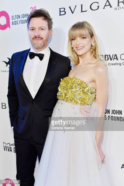 Kyle Newman and Jaime King attend the 26th annual Elton John AIDS Foundation Academy Awards Viewing Party sponsored by Bulgari celebrating EJAF and...