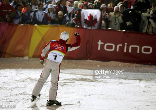 Kyle Nissen of Canada celebrates to the crowd after his first jump of the Mens Freestyle Skiing Aerials Final on Day 13 of the 2006 Turin Winter...