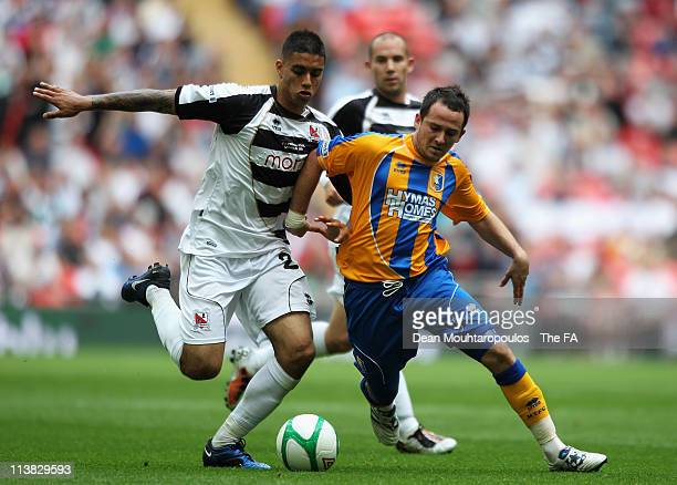 Kyle Nix of Mansfield battles for the ball with Aman Verma of Darlington during the FA Trophy Final between Darlington and Mansfield Town at Wembley...