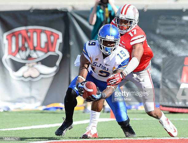 Kyle Nunn of the San Jose State Spartans catches a 30yard touchdown pass in the end zone as Kenneth Penny of the UNLV Rebels defends during the first...
