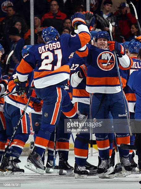 Kyle Okposo and Josh Bailey of the New York Islanders celebrate the Islanders 43 overtime victory over the Toronto Maple Leafs at the Nassau Coliseum...