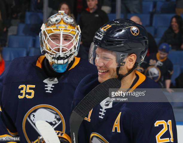 Kyle Okposo and Linus Ullmark of the Buffalo Sabres celebrate their 31 win against the Columbus Blue Jackets in an NHL game on January 11 2018 at...