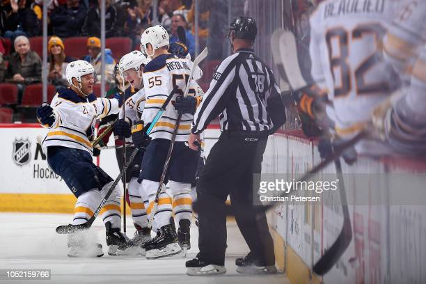 Kyle Okposo Casey Mittelstadt Jeff Skinner and Rasmus Ristolainen of the Buffalo Sabres celebrate after Skinner scored a goal against the Arizona...