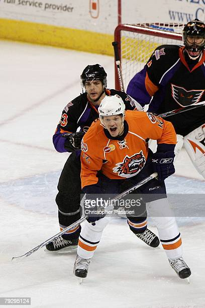 Kyle Okposo of the Bridgeport Sound Tigers is checked from behind by Denis Gauthier of the Philadelphia Phantoms during the first period on January...