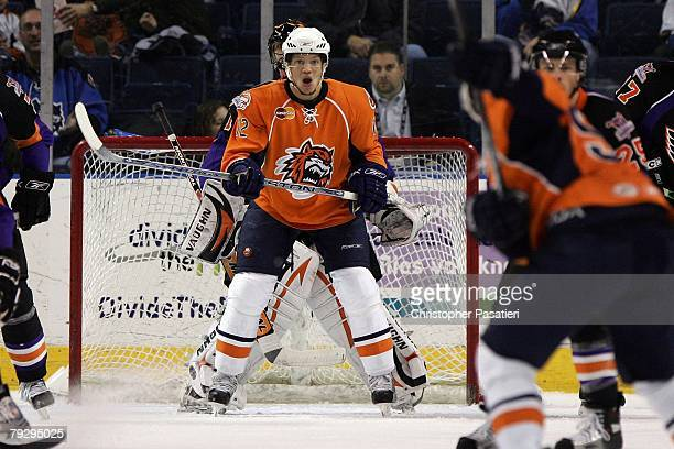 Kyle Okposo of the Bridgeport Sound Tigers screens goaltender Brian Boucher of the Philadelphia Phantoms during the second period on January 23, 2008...