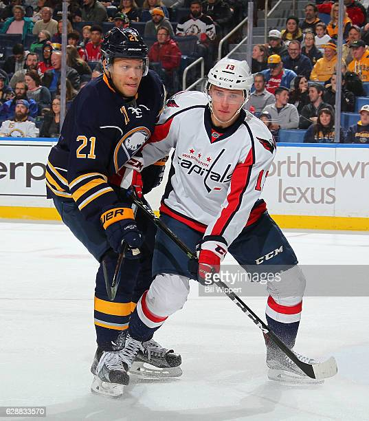 Kyle Okposo of the Buffalo Sabres and Jakub Vrana of the Washington Capitals battle for position during an NHL game at the KeyBank Center on December...