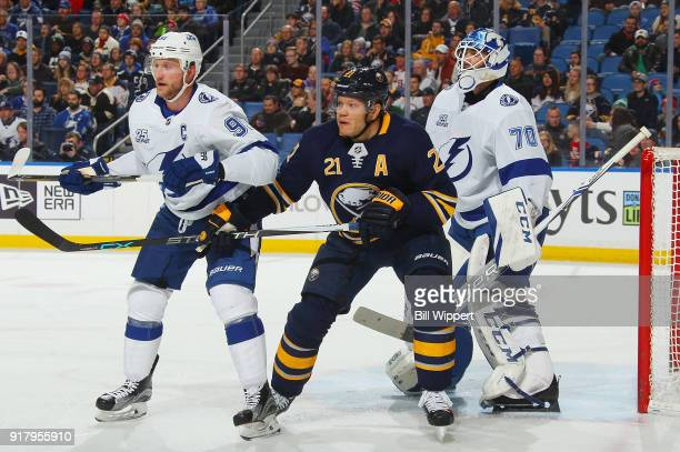 Kyle Okposo of the Buffalo Sabres battles for position with Steven Stamkos of the Tampa Bay Lightning while screening Louis Domingue during an NHL...