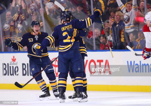 Kyle Okposo of the Buffalo Sabres celebrates with Jeff Skinner after scoring the winning goal late in the third period against the Montreal Canadiens...