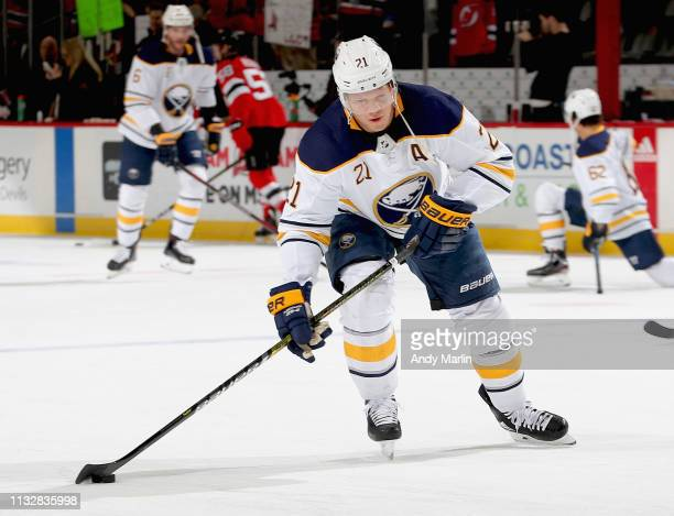 Kyle Okposo of the Buffalo Sabres takes a shot during warmups prior to the game against the New Jersey Devils at Prudential Center on March 25 2019...