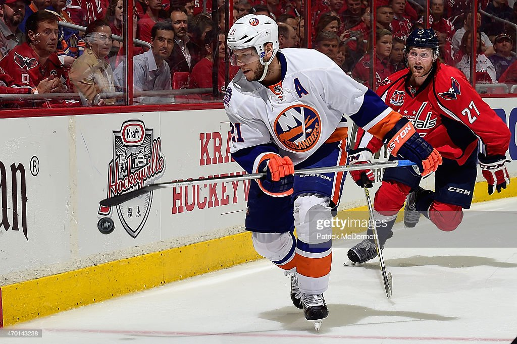 Kyle Okposo #21 of the New York Islanders controls the puck behind the net against Karl Alzner #27 of the Washington Capitals during the third period in Game Two of the Eastern Conference Quarterfinals during the 2015 NHL Stanley Cup Playoffs at Verizon Center on April 17, 2015 in Washington, DC.