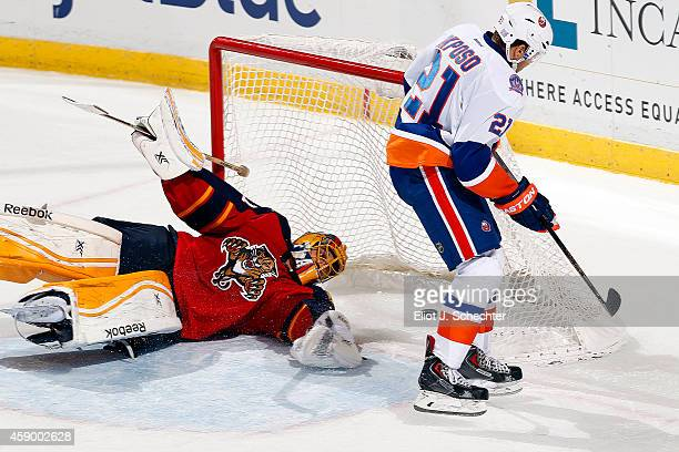 Kyle Okposo of the New York Islanders scores the game winning goal in a shoot out against Goaltender Roberto Luongo of the Florida Panthers at the...