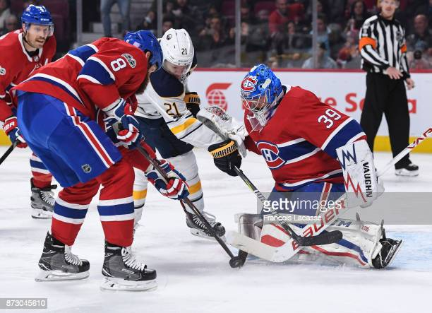 Kyle Okposo the Buffalo Sabres tries to scores a goal on goaltender Charlie Lindgren of the Montreal Canadiens after a rebound in the NHL game at the...