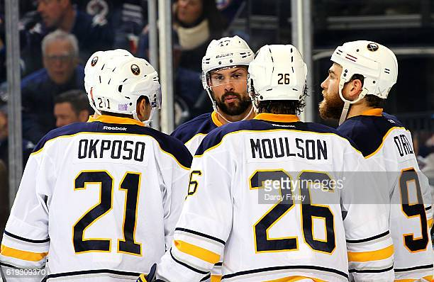 Kyle Okposo Zach Bogosian Matt Moulson and Ryan O'Reilly of the Buffalo Sabres discuss strategy during a third period stoppage in play against the...