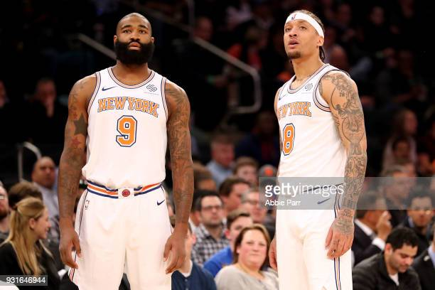 Kyle O'Quinn and Michael Beasley of the New York Knicks have a conversation in the first quarter against the Dallas Mavericks during their game at...