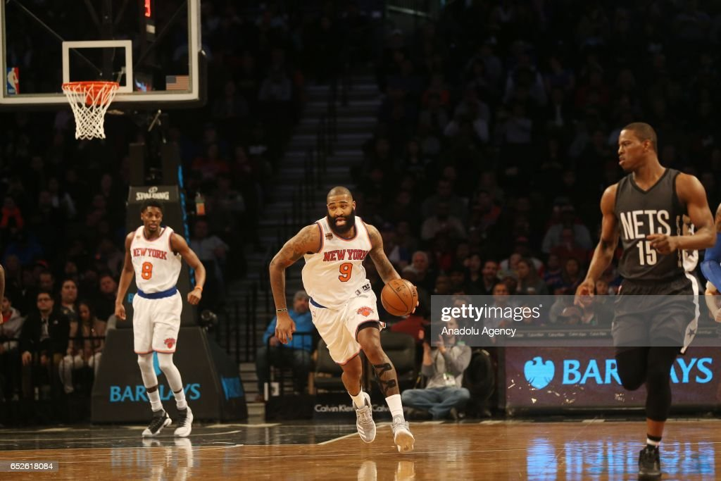 Kyle O'Quinn #9 Jutine Holiday (L) #8 of New York Knicks runs as Isaiah Whitehead #15 (R) of Brooklyn Nets approaches them during Brooklyn Nets vs New York Knicks NBA game in Barclays Center in Brooklyn borough of New York , U.S.A on March 12, 2017.