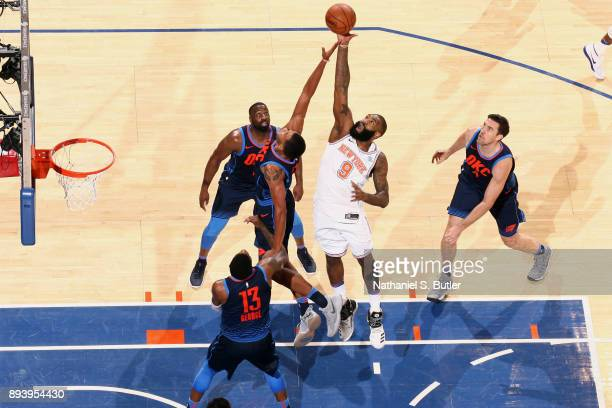 Kyle O'Quinn of the New York Knicks and Josh Huestis of the Oklahoma City Thunder jump for the rebound on December 16 2017 at Madison Square Garden...