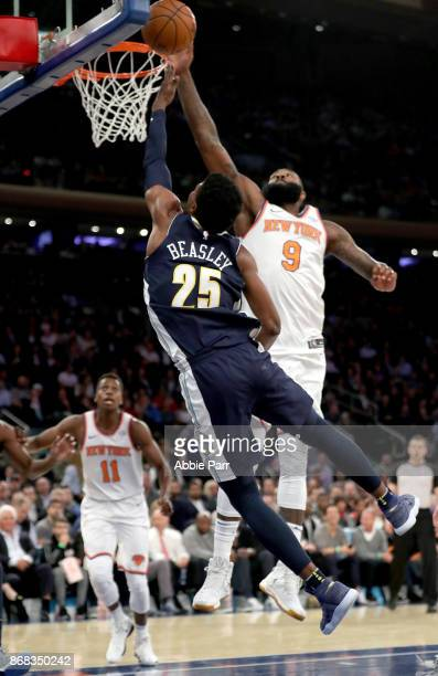 Kyle O'Quinn of the New York Knicks blocks a shot against Malik Beasley of the Denver Nuggets in the second quarter during their game at Madison...