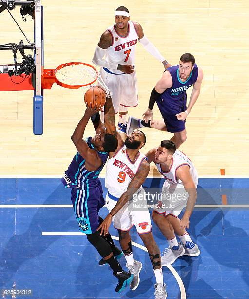 Kyle O'Quinn of the New York Knicks blocks the shot from Marvin Williams of the Charlotte Hornets at Madison Square Garden in New York New York NOTE...