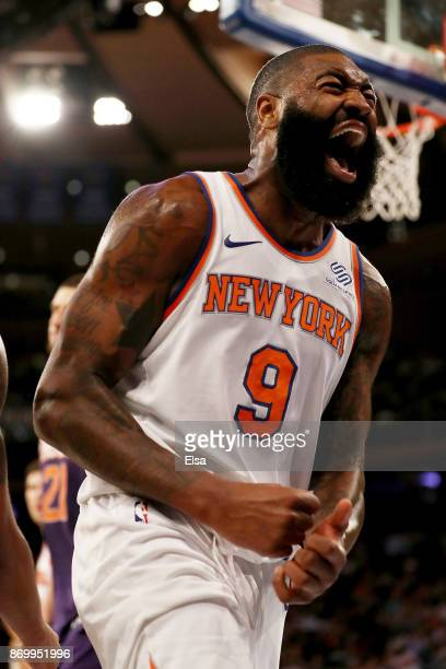Kyle O'Quinn of the New York Knicks celebrates after he drew the foul in the second half against the Phoenix Suns at Madison Square Garden on...