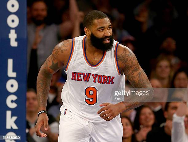 Kyle O'Quinn of the New York Knicks celebrates his basket in the second half against the Brooklyn Nets at Madison Square Garden on April 1 2016 in...