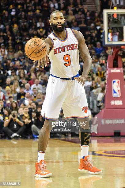 Kyle O'Quinn of the New York Knicks controls the ball against the Cleveland Cavaliers on October 25 2016 at Quicken Loans Arena in Cleveland Ohio...