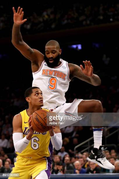 Kyle O'Quinn of the New York Knicks defends against Jordan Clarkson of the Los Angeles Lakers in the first half during their game at Madison Square...
