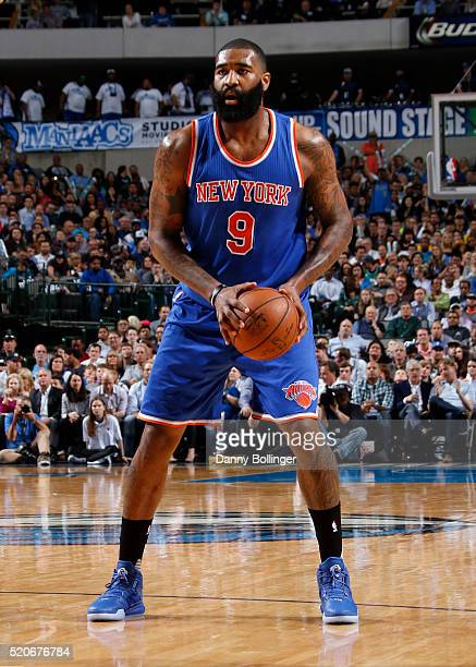 Kyle O'Quinn of the New York Knicks dribbles the ball against the Dallas Mavericks on March 30 2016 at the American Airlines Center in Dallas Texas...
