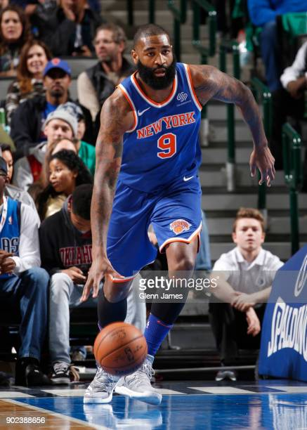 Kyle O'Quinn of the New York Knicks dribbles the ball during the game against the Dallas Mavericks on January 7 2018 at the American Airlines Center...