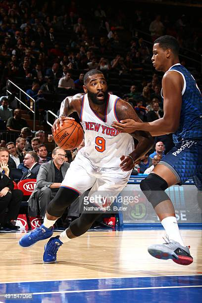Kyle O'Quinn of the New York Knicks drives to the basket against Bauru during a preseason game on October 7 2015 at Madison Square Garden in New York...
