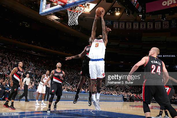 Kyle O'Quinn of the New York Knicks goes to the basket against the Portland Trail Blazers on November 22 2016 at Madison Square Garden in New York...