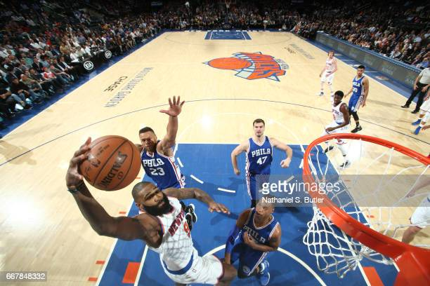 Kyle O'Quinn of the New York Knicks goes to the basket against the Philadelphia 76ers on April 12 2017 at Madison Square Garden in New York City New...