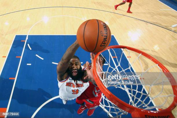 Kyle O'Quinn of the New York Knicks goes to the basket against the Houston Rockets on November 1 2017 at Madison Square Garden in New York City New...