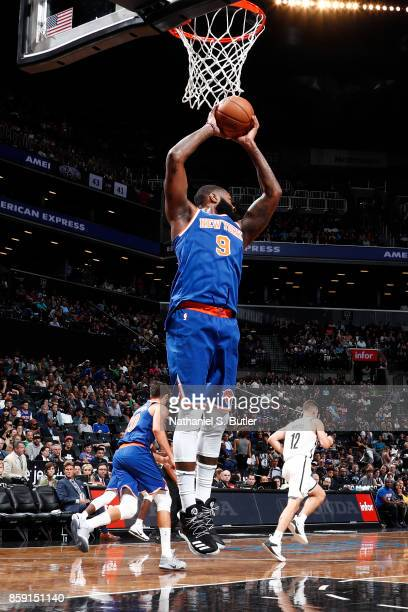 Kyle O'Quinn of the New York Knicks grabs the rebound against the Brooklyn Nets during a preseason game on October 8 2017 at Barclays Center in...
