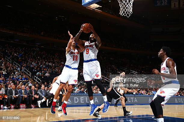 Kyle O'Quinn of the New York Knicks grabs the rebound against the Brooklyn Nets at Madison Square Garden in New York City on OCTOBER 8 2016 NOTE TO...