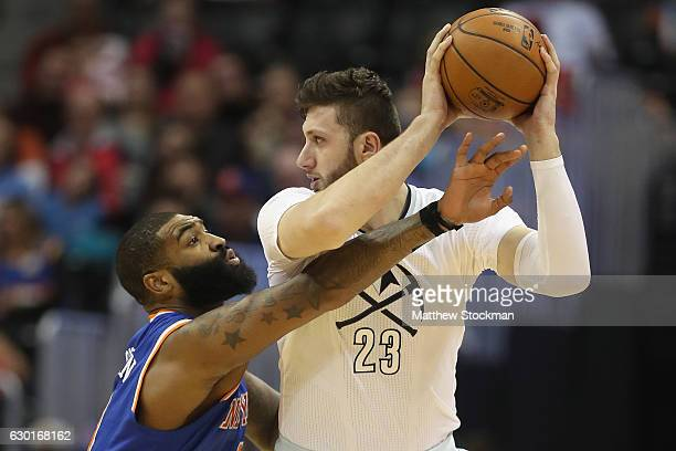 Kyle O'Quinn of the New York Knicks guards Jusuf Nurkic of the Denver Nuggets at the Pepsi Center on December 17 2016 in Denver Colorado NOTE TO USER...