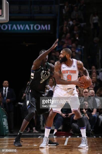 Kyle O'Quinn of the New York Knicks handles the ball against the Milwaukee Bucks on February 2 2018 at the BMO Harris Bradley Center in Milwaukee...