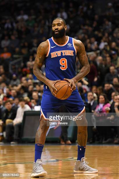 Kyle O'Quinn of the New York Knicks handles the ball during a game against the Milwaukee Bucks at the Bradley Center on March 9 2018 in Milwaukee...