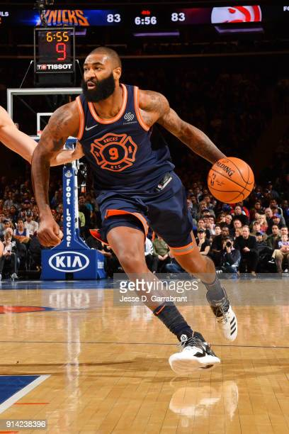 Kyle O'Quinn of the New York Knicks handles the ball during the game against the Atlanta Hawks on February 4 2018 in New York City New York at...