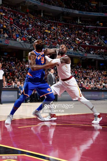 Kyle O'Quinn of the New York Knicks Jeff Green of the Cleveland Cavaliers defend their positions during the game between the two teams on October 29...