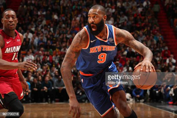 Kyle O'Quinn of the New York Knicks jocks for a position against the Miami Heat on January 5 2018 at American Airlines Arena in Miami Florida NOTE TO...