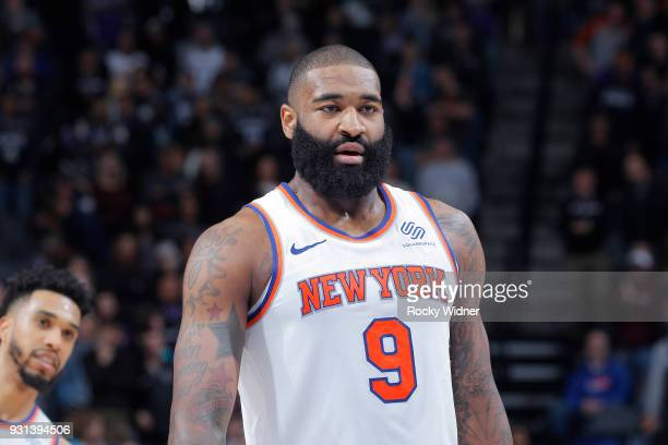 Kyle O'Quinn of the New York Knicks looks on during the game against the Sacramento Kings on March 4 2018 at Golden 1 Center in Sacramento California...
